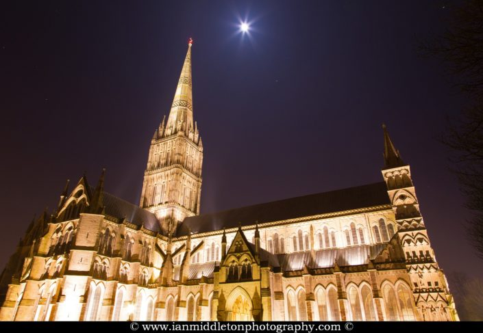 Salisbury cathedral on a moonlit evening, Wiltshire, England. Shot as the moon shone over the spire just after dusk.