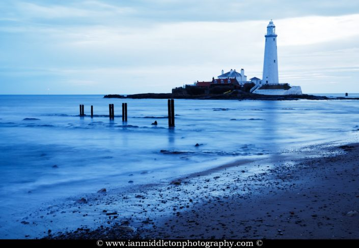 Saint Mary's Lighthouse on Saint Mary's Island, situated north of Whitley Bay, Tyne and Wear, North East England. Seen early morning from the beach beside the causeway that runs out to the island. Whitley Bay is situated just north of Newcastle.