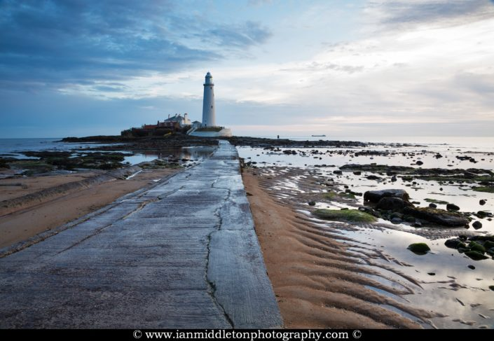 Saint Mary's Lighthouse on Saint Mary's Island, situated north of Whitley Bay, Tyne and Wear, North East England. Seen at sunrise from the beach beside the causeway that runs out to the island. Whitley Bay is situated just north of Newcastle.