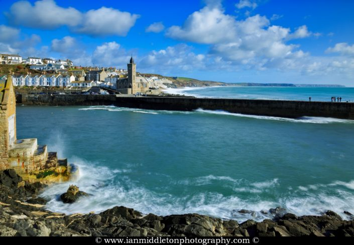 Porthleven Beach, near Helston in Cornwall, England. The Bickford-Smith Institute is visible on the left. Although it looks like a church, is actually the town's council office and a snooker hall.