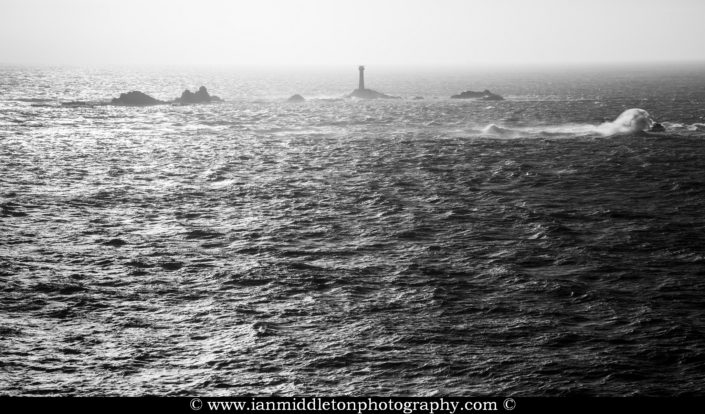 Longships Lighthouse at Lands End, photographed at sundown. Built on the Longships rocks in 1875 at the far southwestern tip of the British Isles, a notoriously deadly section of ocean.