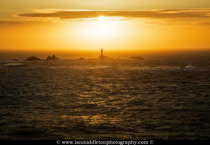 Longships Lighthouse at Lands End, photographed at sunset. Built on the Longships rocks in 1875 at the far southwestern tip of the British Isles, a notoriously deadly section of ocean.