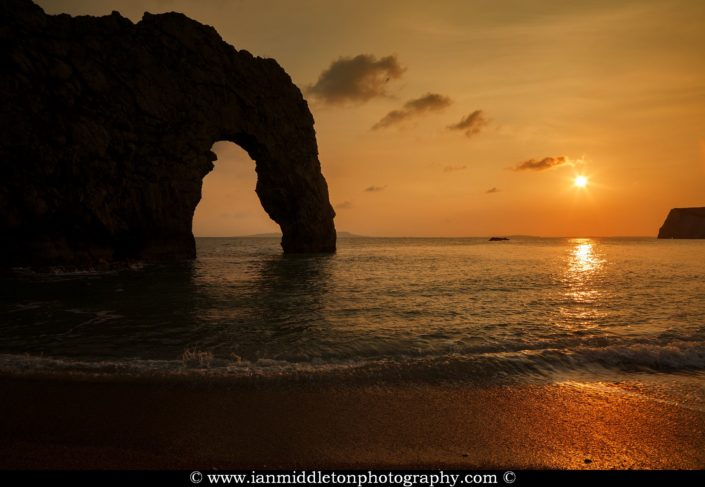Durdle Door beach as the sun disappears for the day, Dorset, England. Durdle door is one of the many stunning locations to visit on the Jurassic coast in southern England.