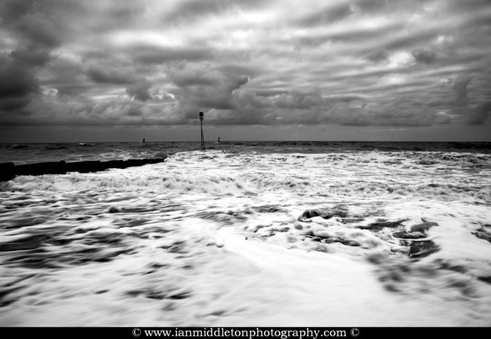 Stormy weather at Hunstanton beach in black and white, West Norfolk, England.