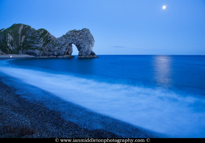 Durdle Door in the moonlight, Dorset, England. Durdle door is one of the many stunning locations to visit on the Jurassic coast in southern England.