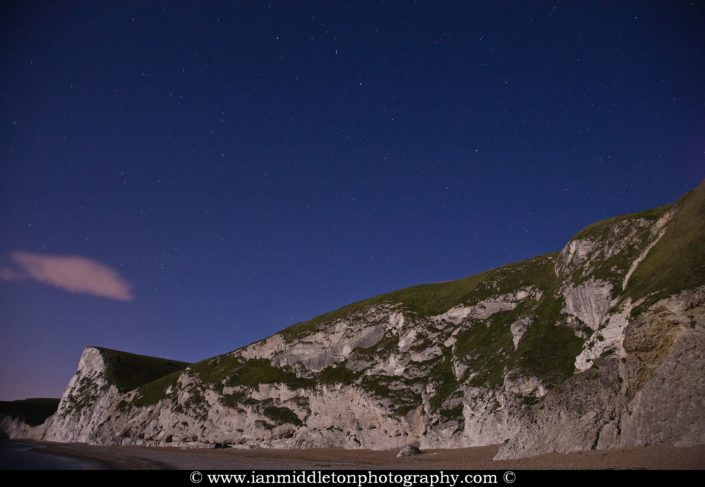 The Big dipper (Ursa Major) constellation on a moonlit light at Durdle Door beach, Dorset, England. Durdle door is one of the many stunning locations to visit on the Jurassic coast in southern England.