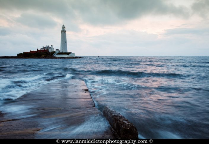 Saint Mary's Lighthouse on Saint Mary's Island, situated north of Whitley Bay, Tyne and Wear, North East England. Seen in the evening from the causeway that runs out to the island. Whitley Bay is situated just north of Newcastle.