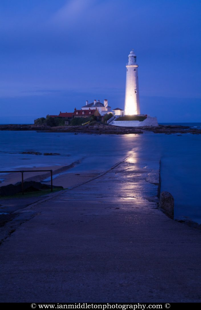 Saint Mary's Lighthouse on Saint Mary's Island, situated north of Whitley Bay, Tyne and Wear, North East England. Seen at dusk from the the causeway that runs out to the island. Whitley Bay is situated just north of Newcastle.
