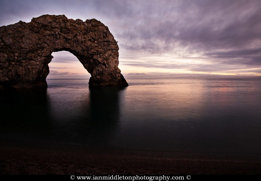 Evening view of Durdle Door, Dorset, England. Durdle door is one of the many stunning locations to visit on the Jurassic coast in southern England.