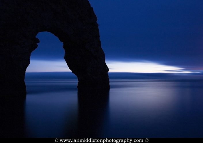 Close up of Durdle Door as the last wisp of light disappears over the horizon at dusk, Dorset, England. Durdle door is one of the many stunning locations to visit on the Jurassic coast in southern England.