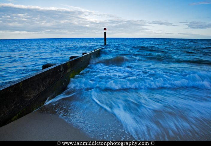 Waves coming in near a Groyne at Bournemouth beach and seafront, Dorset, UK