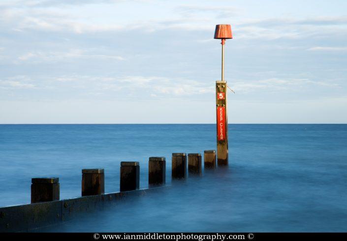 Bournemouth Beach groyne, at sunset, Dorset, England