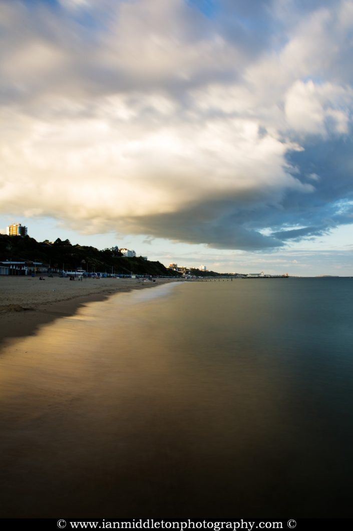 Bournemouth seafront as a storm cloud drifts over in the evening.