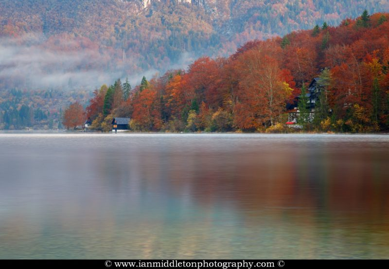 Beautiful light and clouds scattering over Bohinj Lake on an autumn morning, Triglav National Park, Slovenia.