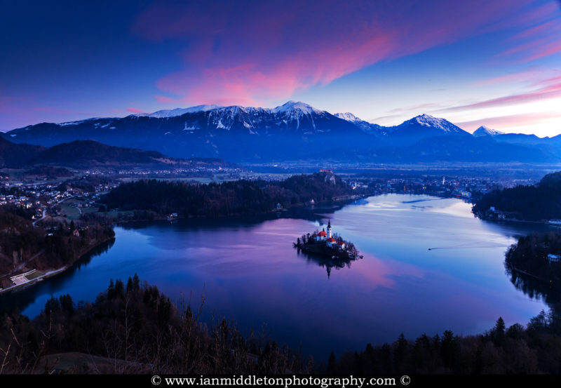 Sunrise over Lake Bled to the island church and clifftop castle from Mala Osojnica, Slovenia.