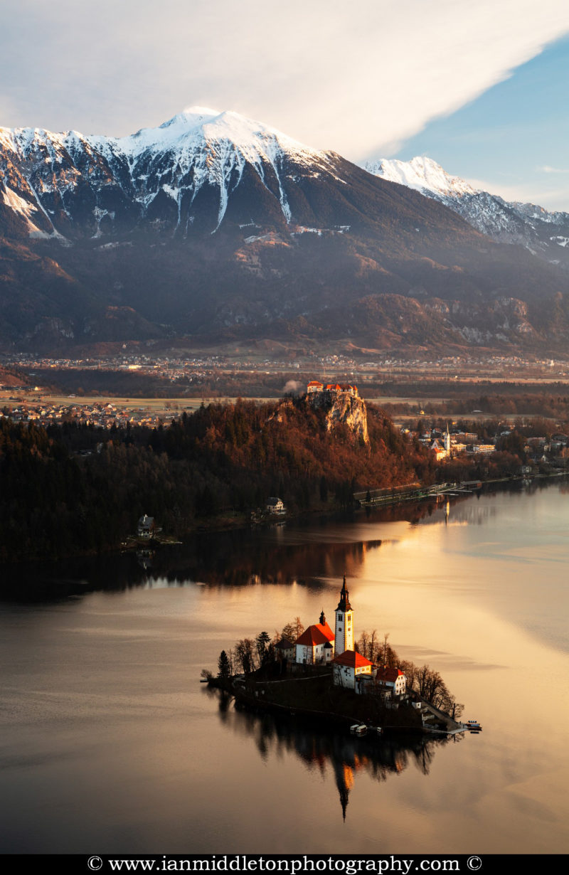 Morning view across Lake Bled to the island church and clifftop castle from Mala Osojnica, Slovenia.