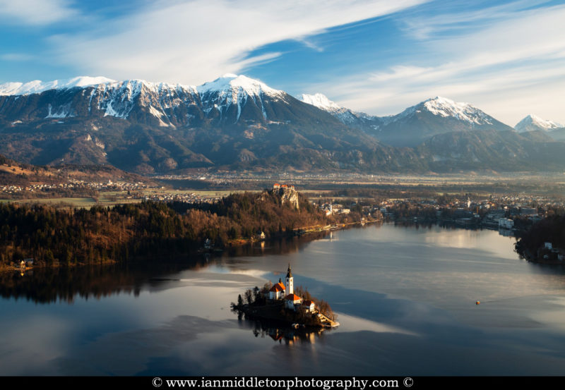 Morning over Lake Bled to the island church and clifftop castle from Mala Osojnica, Slovenia.