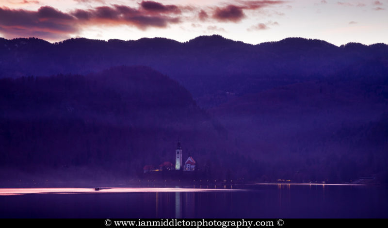 View across the beautiful Lake Bled, island church at sunset, Slovenia. Lake Bled is Slovenia's most popular tourist destination.