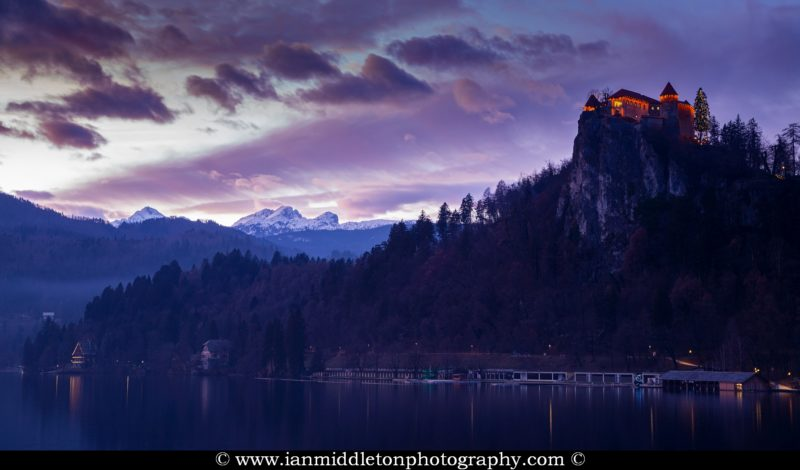 Sunset over Lake Bled and the hilltop castle with the Julian Alps in the background, Slovenia.