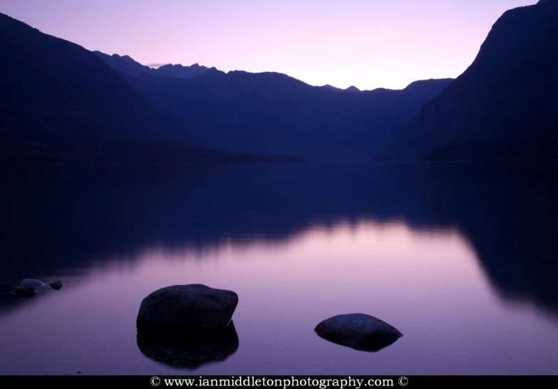 The Julian Alps reflected in Lake Bohinj at sunset, Triglav National Park, Slovenia