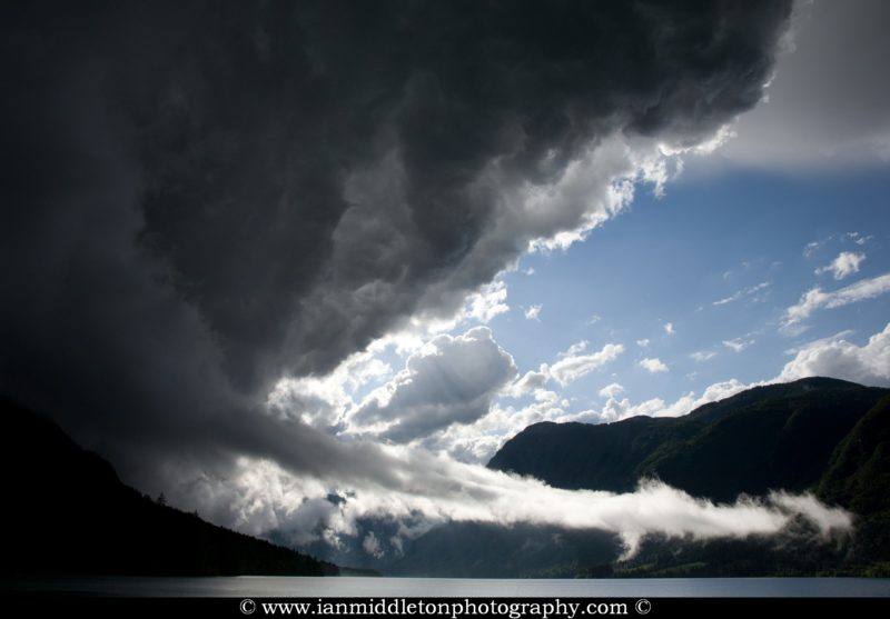 Second set of storm clouds gathering over Bohinj Lake just after a previous massive storm blew over the Bohinj valley, Triglav National Park, Slovenia.
