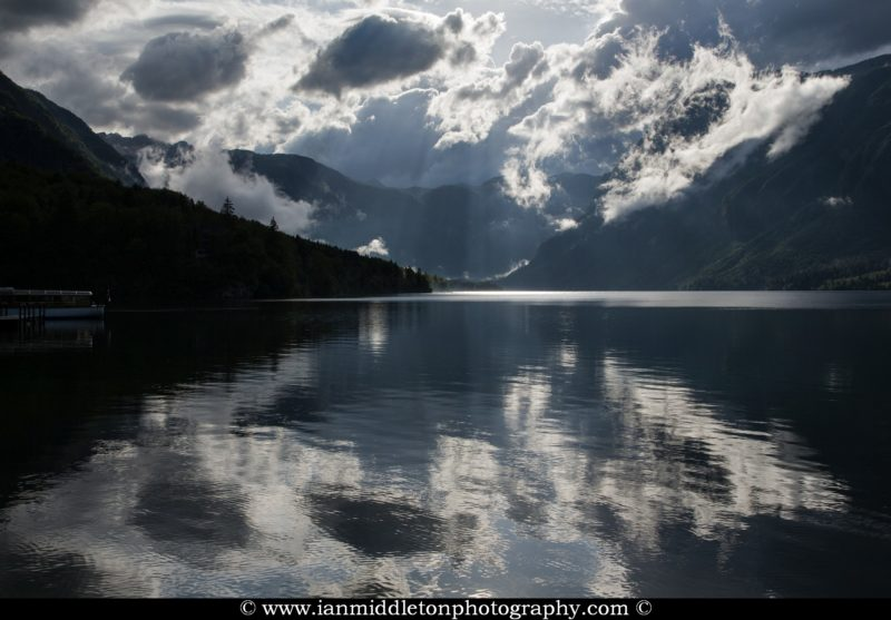 Beautiful light, sunrays and clouds scattering over Bohinj Lake after a massive summer storm blew over the Bohinj valley, Triglav National Park, Slovenia.