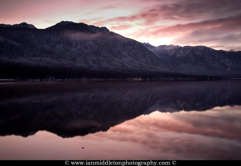 The Julian Alps reflected in Lake Bohinj at the first sunset of the new year, Triglav National Park, Slovenia. Taken New Year Day 2012.
