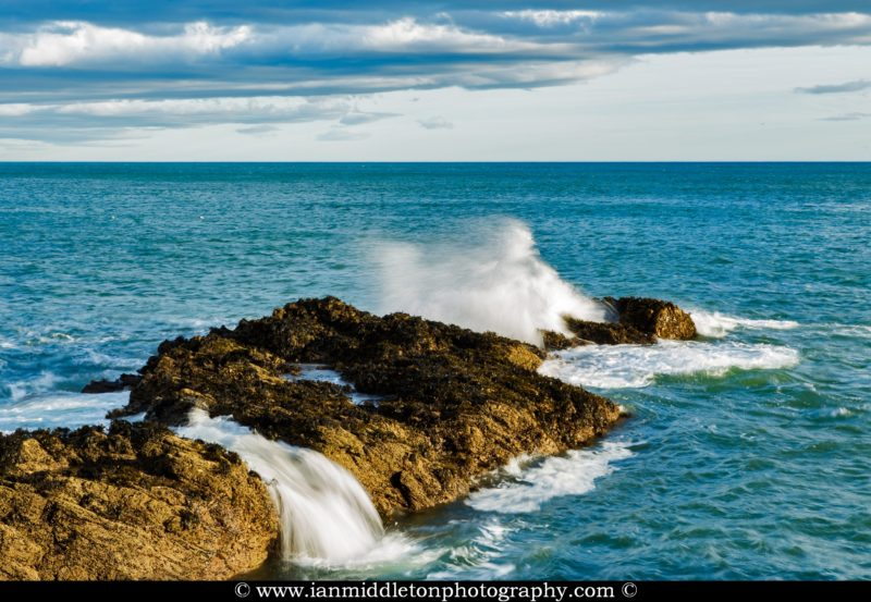 Waves crashing over rocks at Portlethen, near Aberdeen, Scotland.