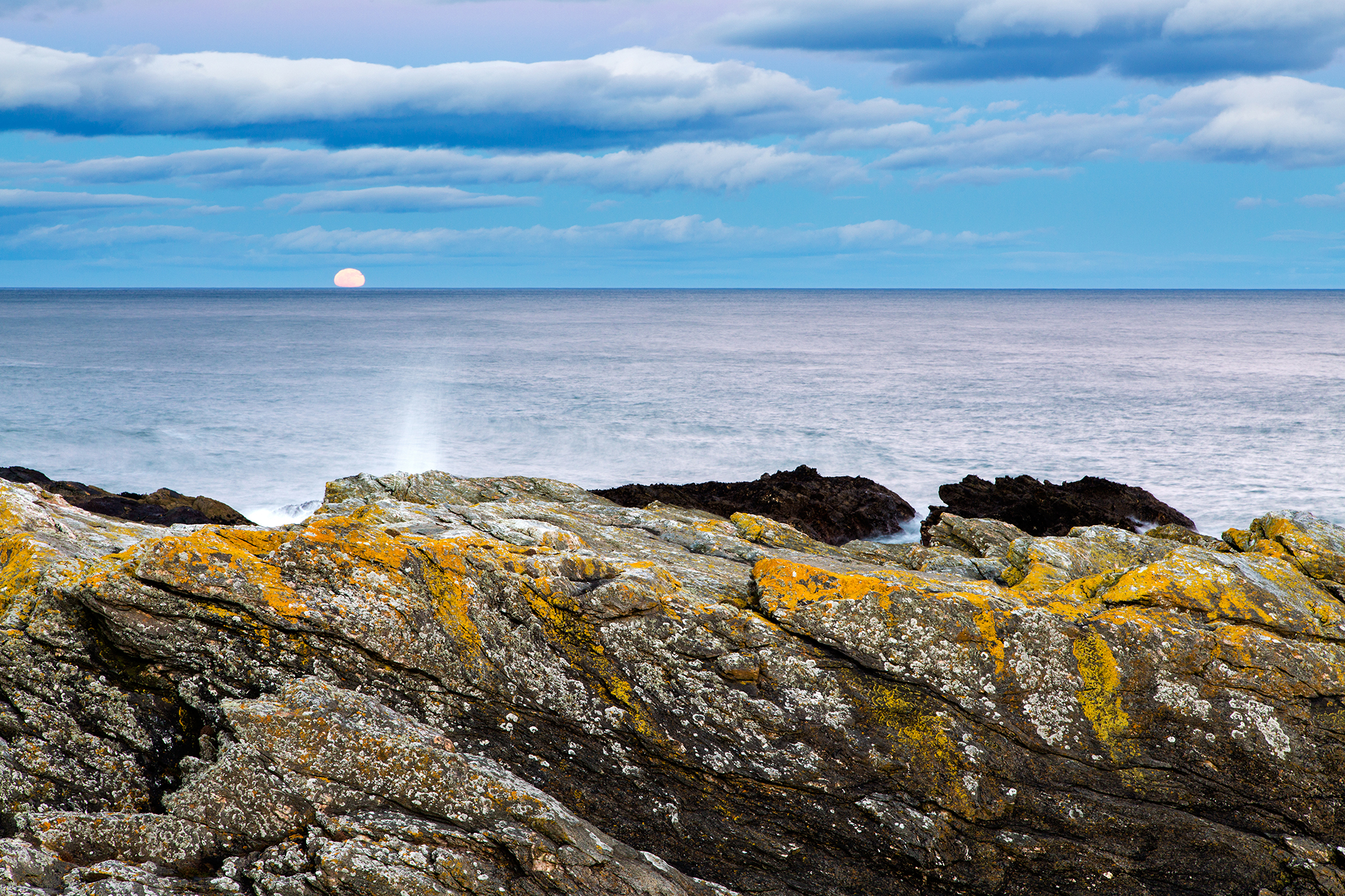 Moon rising after sunset at Portlethen, near Aberdeen, Scotland.