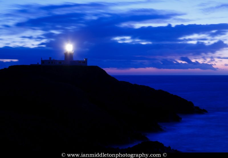 Lighthouse at Strumble Head at dusk, Pembrokeshire, Wales