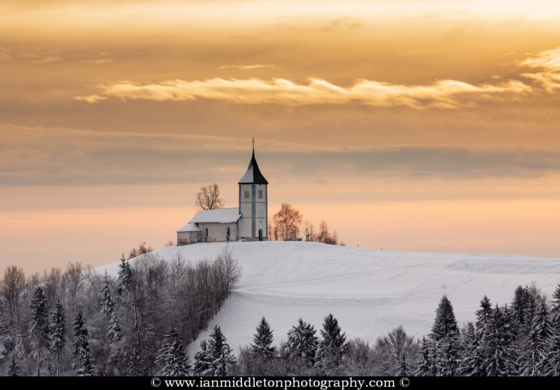 Jamnik church of Saints Primus and Felician in the morning in winter, perched on a hill on the Jelovica Plateau, Slovenia.
