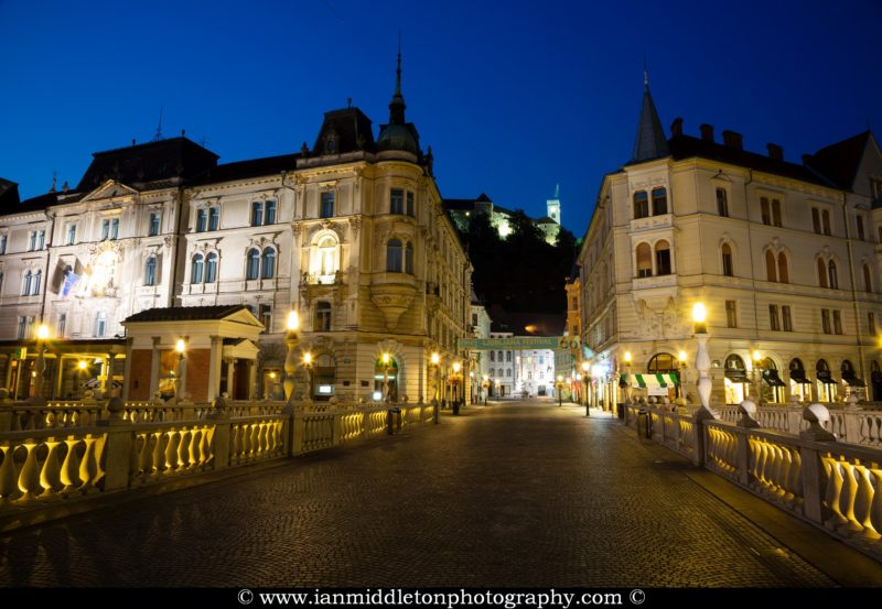 View across the Triple Bridge (tromostovje) towards the old town and Ljubljana Castle in Ljubljana, Slovenia. All this region was designed by Slovenia's most celebrated architect, Joze Plecnik.
