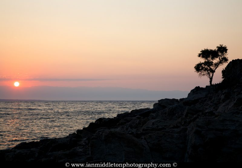 Sunrise over the rocky coastal area of Cunski. Cunski lies just 8kms north of Mali Losinj on Losinj Island, Croatia.