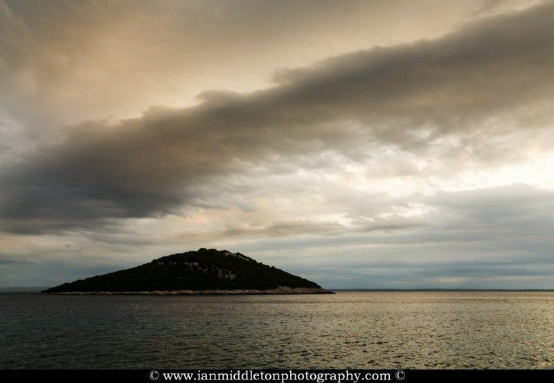 Storm moving in over Veli Osir Island in the morning, seen from Zaosiri Beach, Cunski on Losinj Island, Croatia.