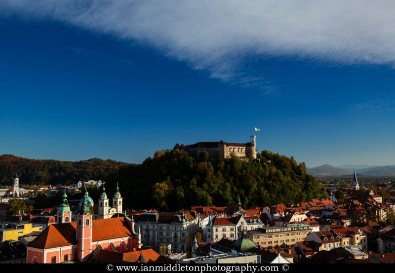 View across Preseren Square with the franciscan church, triple bridge and castle on the hill in Ljubljana, Slovenia. Seen from the Neboticnik skyscraper.