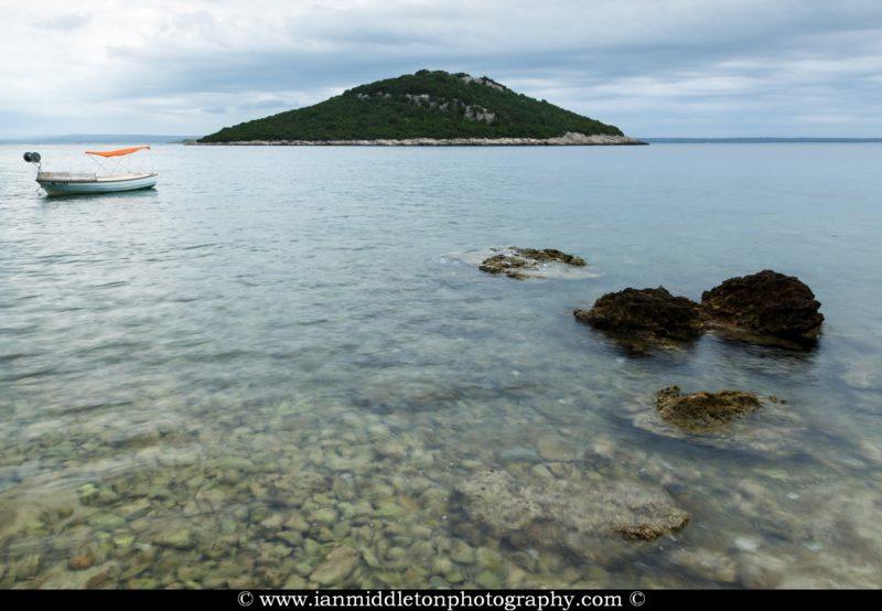 Morning light over the rocky coastal area of Cunski and the island of Veli Osir, Seen from Zaosiri beach. Cunski lies just 8kms north of Mali Losinj on Losinj Island, Croatia.