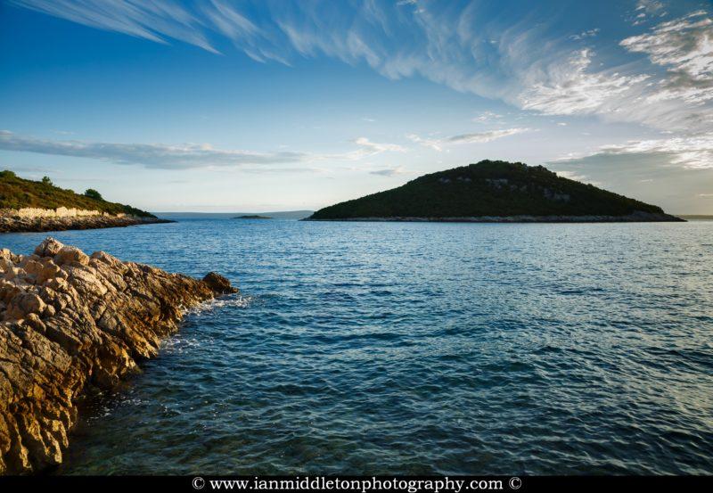 The soft morning light illuminates the sea around Veli Osir and Mali Osir Islands, Losinj Island, Croatia. Seen from Zaosiri Beach at Cunski, a small village that lies just 8kms north of Mali Losinj on Losinj Island, Croatia.