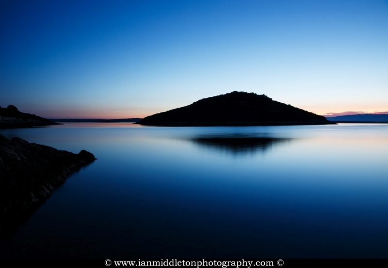 Dawn over the two small islands of Veli Osir and Mali Osir on Losinj Island, Adriatic Sea, Croatia. Photographed from Osiri beach near the village of Cunski.