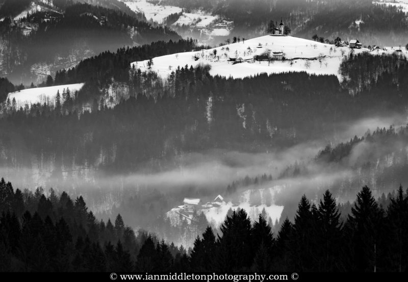 Morning view in winter from Rantovše hill across to Sveti Tomaz nad Praprotnim (church of Saint Thomas) and the Kamnik Alps, Slovenia.