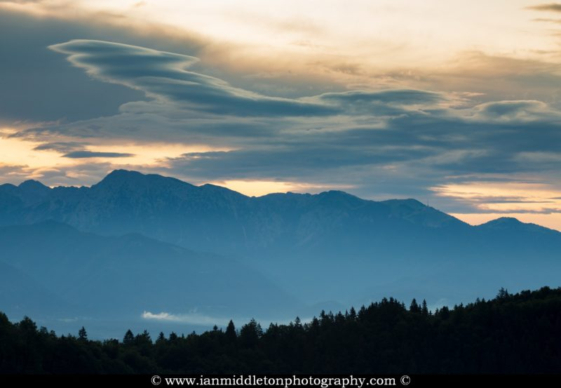 Lenticular clouds over the Kamnik Alps with Krvavec Ski resort on the right, Slovenia.