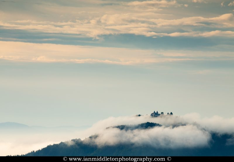 The hills around Jamnik on a summer morning and a view across to the church of Sv Jost above Kranj, Slovenia