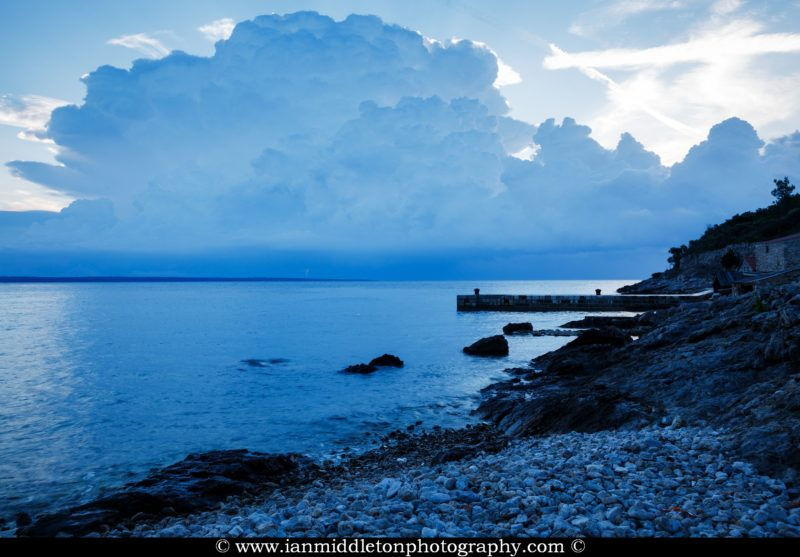 Morning light as a storm moves off over the rocky coastal area of Zaosiri Beach near Cunski. Cunski lies just 8kms north of Mali Losinj on Losinj Island, Croatia.