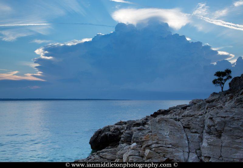 Morning light over the rocky coastal area of Cunski as the morning storm moves away. Cunski lies just 8kms north of Mali Losinj on Losinj Island, Croatia.