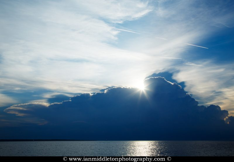Sun bursting through as the storm clouds move away in the morning, seen from Zaosiri Beach, Cunski on Losinj Island, Croatia.