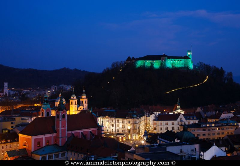 View down to the city centre of Ljubljana with the Ljubljana Castle lit up green to celebrate its status as European Green Capital 2016, Slovenia