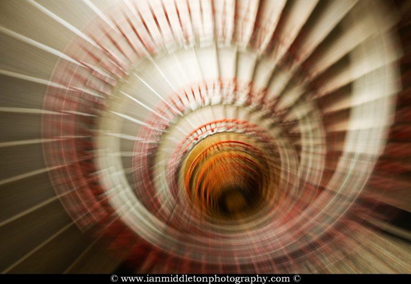Neboticnik spiral stairway with zoom burst effect, Ljubljana, Slovenia.