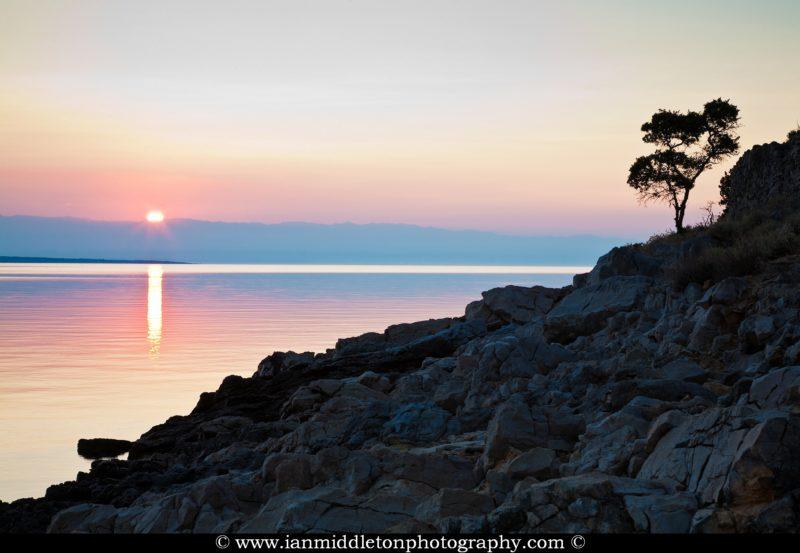 Sunrise over Osiri Beach on the coast area of Cunski, which lies just 8kms north of Mali Losinj on Losinj Island, Croatia.