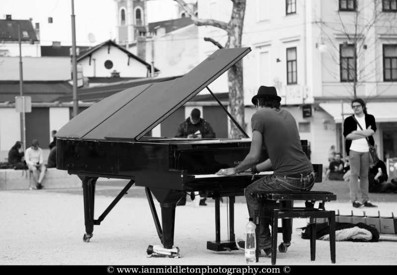 Davide Martello, AKA Klavierkunst (piano art), plays his black grand piano in the park of Kongresni Trg, Ljubljana, Slovenia. Davide is currently travelling the world on a mission to play his grand piano in every capital city in the world. On Tuesday April 16th he played here in Ljubljana. Check out more about Davide on his website: http://www.klavierkunst.com/