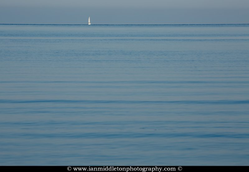 Sailing boat on the Adriatic Sea. Seen from Puntižela Beach, Štinjan north of Pula, Istria, Croatia.