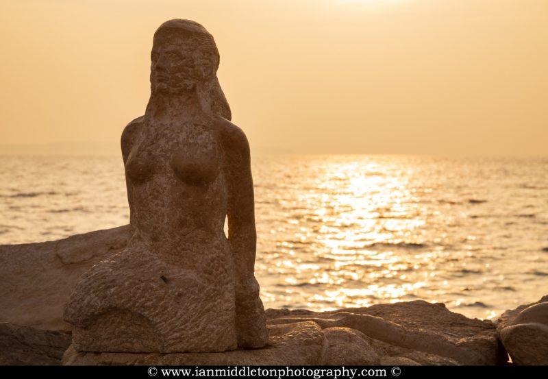 mermaid on the rocks at Piran, Slovenia.